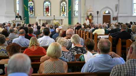 FUNERAL: Family and friends gather at the Holy Rosary Church to celebrate the life of John Faircloth.