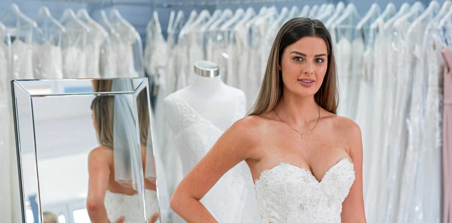 Cheryl shops for her wedding dress in a scene from the TV series Married At First Sight.