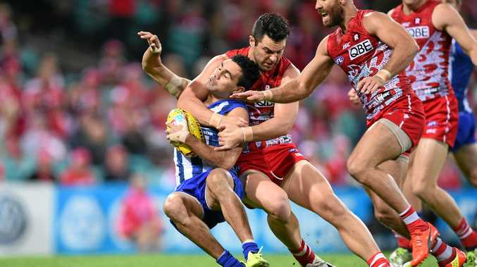 NEW RULES: Heath Grundy is penalised for this high tackle on Lindsay Thomas of the Kangaroos.
