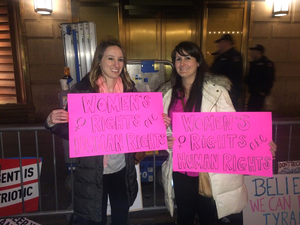 Kim Powell (right) participating in one of the women's marches in New York this week.
