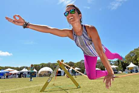 Raquel Hernandez-Cruz  shows some slackline yoga moves to festival-goers.