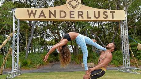The Wanderlust Festival at Novotel Twin Waters Resort: Amy Sinclair and Dylan Werner perform acro yoga.