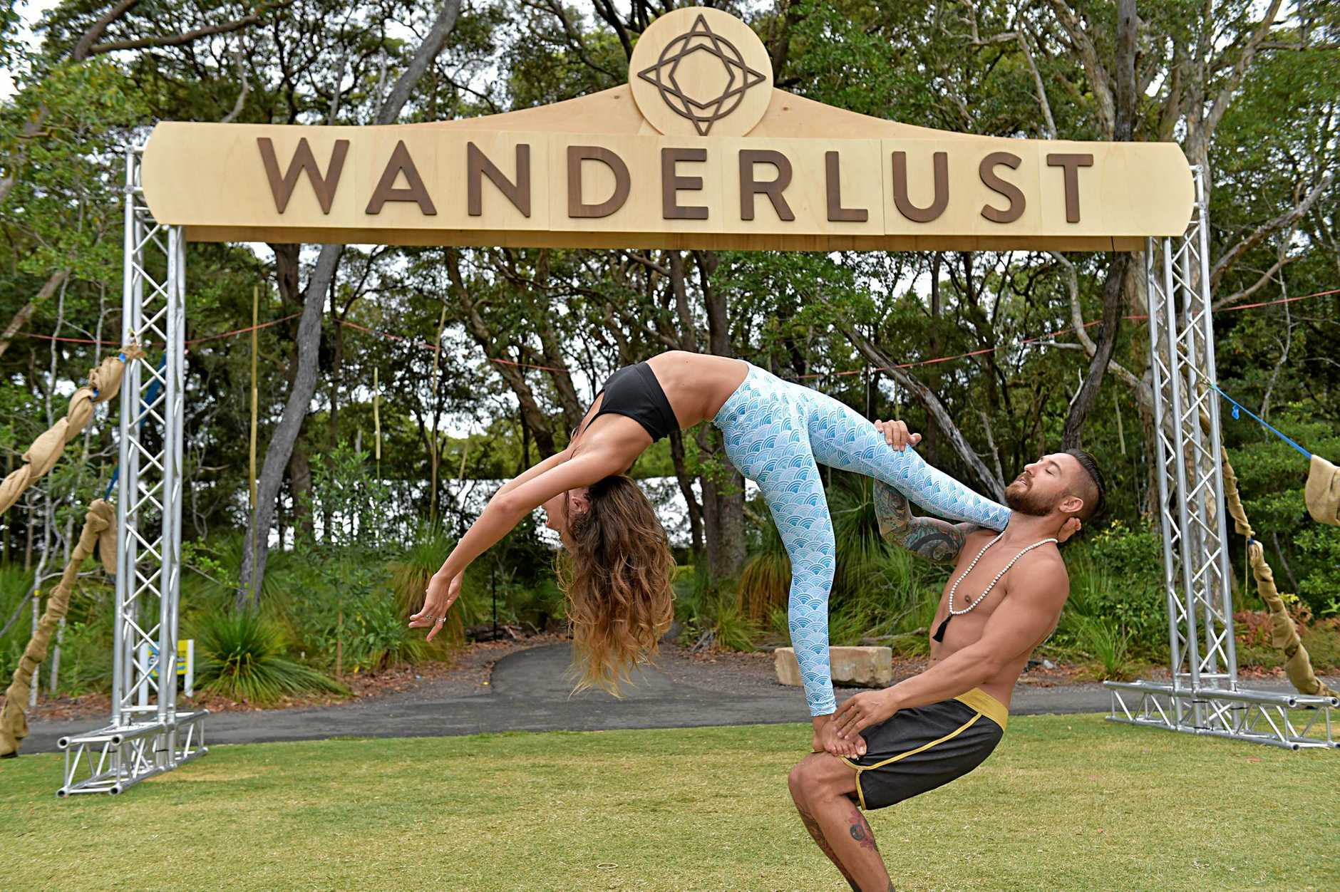 The Wanderlust Festival at Novotel Twin Waters Resort.Amy Sinclair and Dylan Werner perform acro yoga.