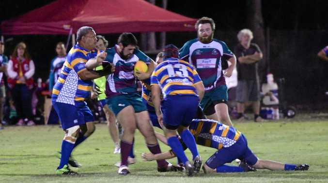 TACKLE: Isis player Luke Walters tries to break through the Falcons defence in their Spring Cup game.