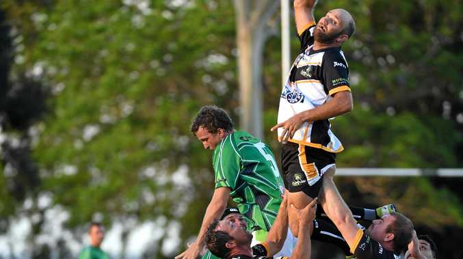 TAP: Turtles player Brendon McKeown reaches for the ball in a lineout against the Pythons in Childers earlier this season.
