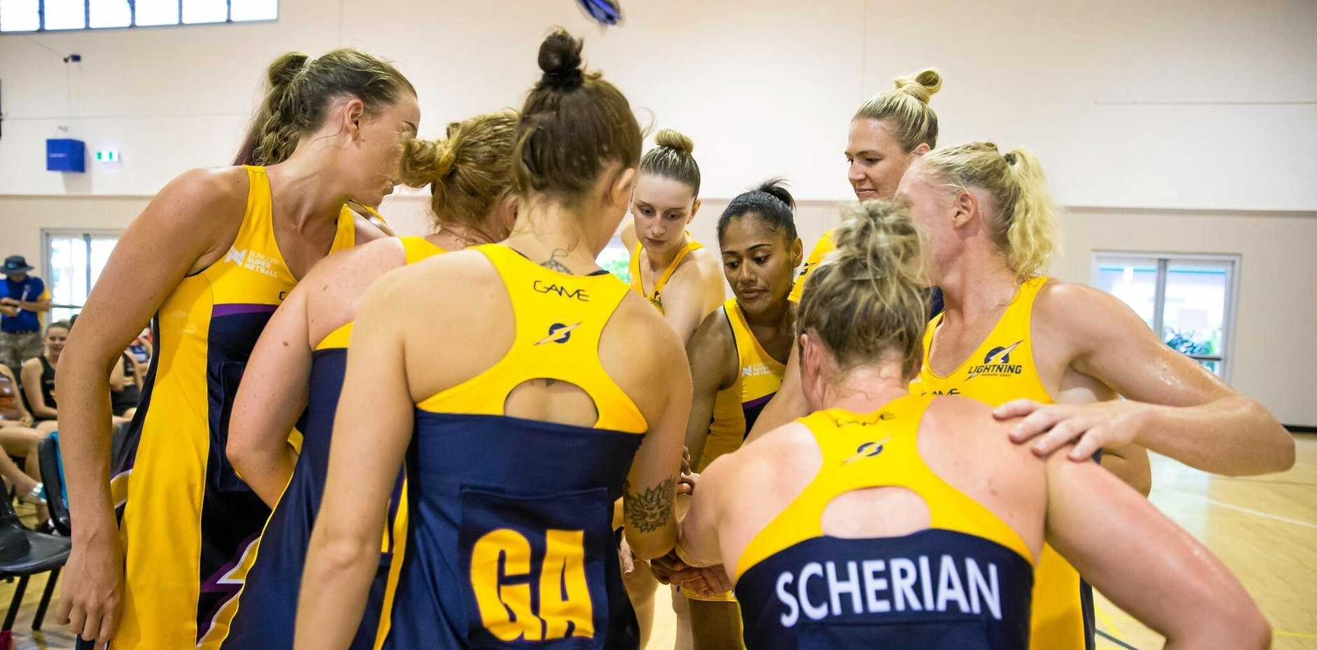 BRAIN STORMING: The Sunshine Coast Lightning players converge during a recent game.