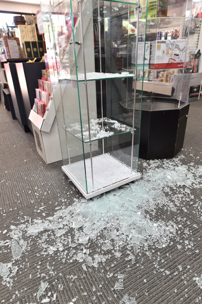Thieves smashed their way into the Torquay Post Office and stole mobile phones.