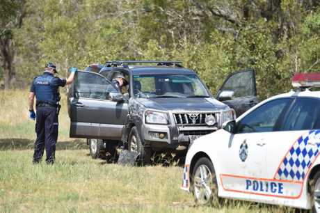 Police forensics investigate a stolen vehicle on vacant land at the end of Smith St in Urangan.