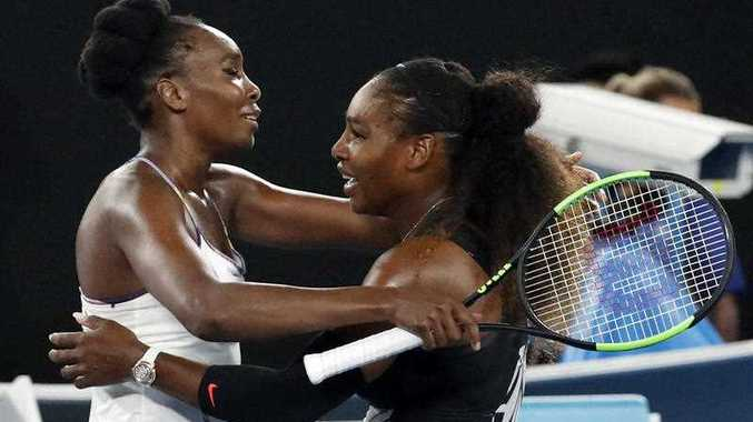 United States' Serena Williams, right, and her sister Venus, left, embrace after Serena won the women's singles final at the Australian Open tennis championships in Melbourne, Australia, Saturday, Jan. 28, 2017.