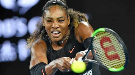 Serena Williams hits a shot during her final against Venus Williams