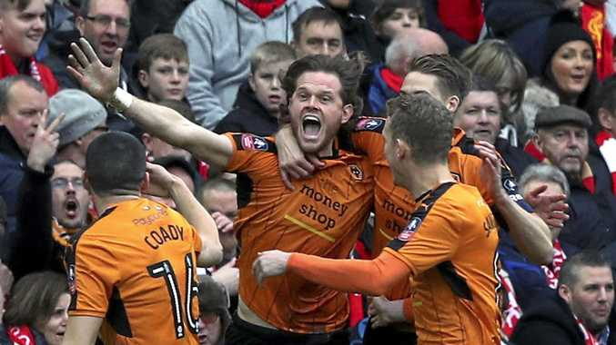 Wolverhampton Wanderers' Richard Stearman (centre) celebrates scoring his side's first goal in the FA Cup fourth-round match against Liverpool.
