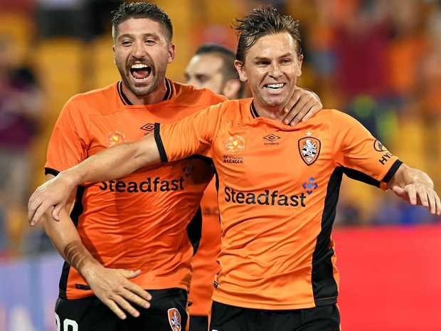 Roar player Brandon Borrello (left) celebrates with teammate Brett Holman after Holman scored the winning goal during the round 17 A-League match against the Western Sydney Wanderers at Suncorp Stadium.