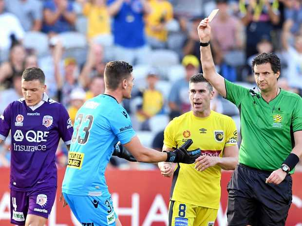 Referee Kris Griffith-Jones (right) issues a red card to Glory goalkeeper Liam Reddy (second from left) after he tripped Trent Buhagiar of the Mariners.