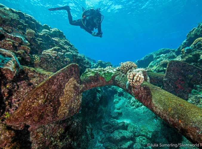 A supplied image obtained Friday, Jan.27, 2017 of Australian National Maritime Museum maritime archaeologist Dr James Hunter photogrammetrically recording an anchor on one of the shipwreck sites discovered at Kenn Reefs, off the Queensland coast, in January 2017.
