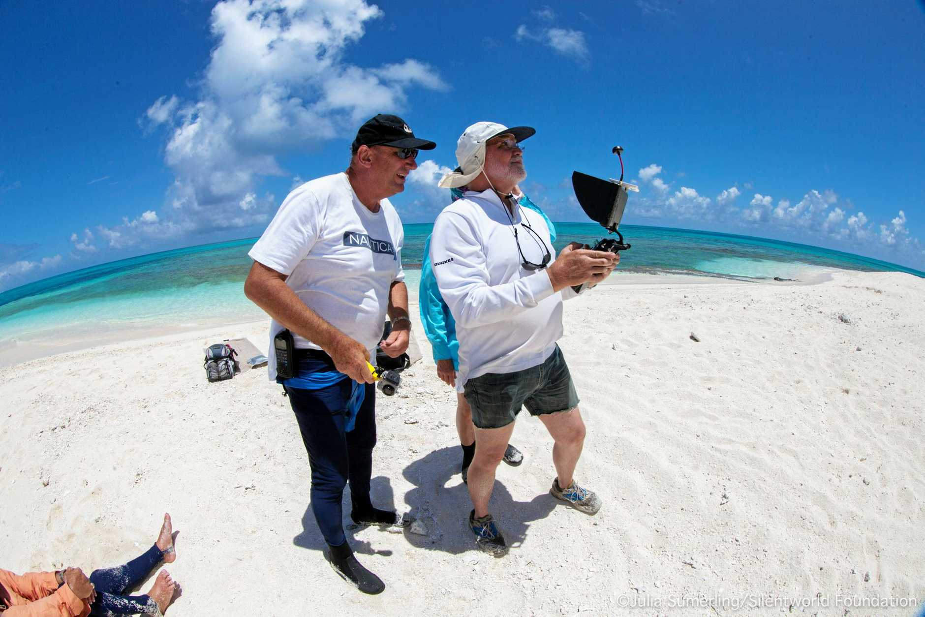 A supplied image obtained Friday, Jan.27, 2017 of John Mullen (left) watching maritime archaeologist and Silentworld Foundation Director Paul Hundley piloting a drone to obtain aerial imagery of historic shipwreck material exposed on the reef top at Kenn Reef, off central Queensland, in January 2017. (AAP Image/ Julia Sumerling, Silentworld Foundation) NO ARCHIVING, EDITORIAL USE ONLY