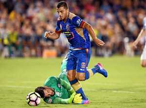 Andrew Nabbout (centre) of the Jets gets past Dean Bouzanis (left) to score a goal during the round 17 A-League match between the Newcastle Jets and Melbourne City FC at  the C.ex Coffs International Stadium in Coffs Harbour on Friday, Jan. 27, 2017. (AAP Image/Paul Miller) NO ARCHIVING, EDITORIAL USE ONLY