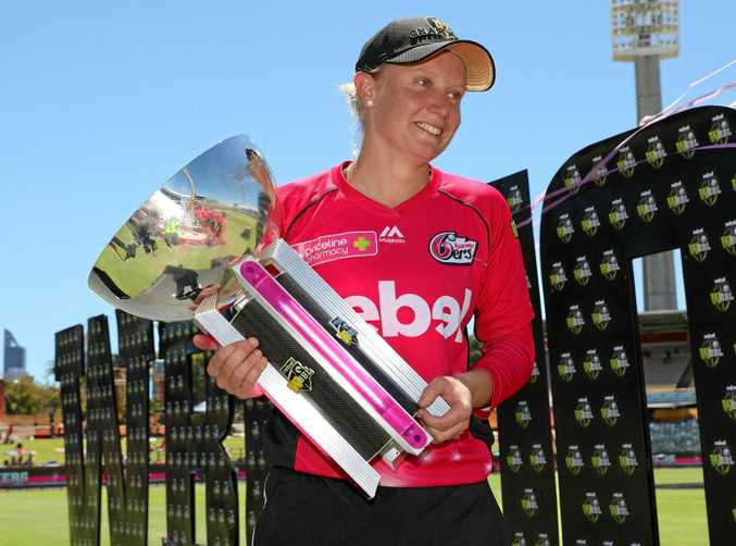 Alyssa Healy of the Sixers holds the trophy after her team won the WBBL02 title.