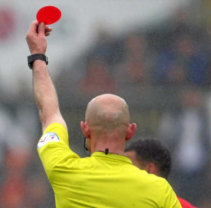 A player in Scotland was sent off for urinating during a game.