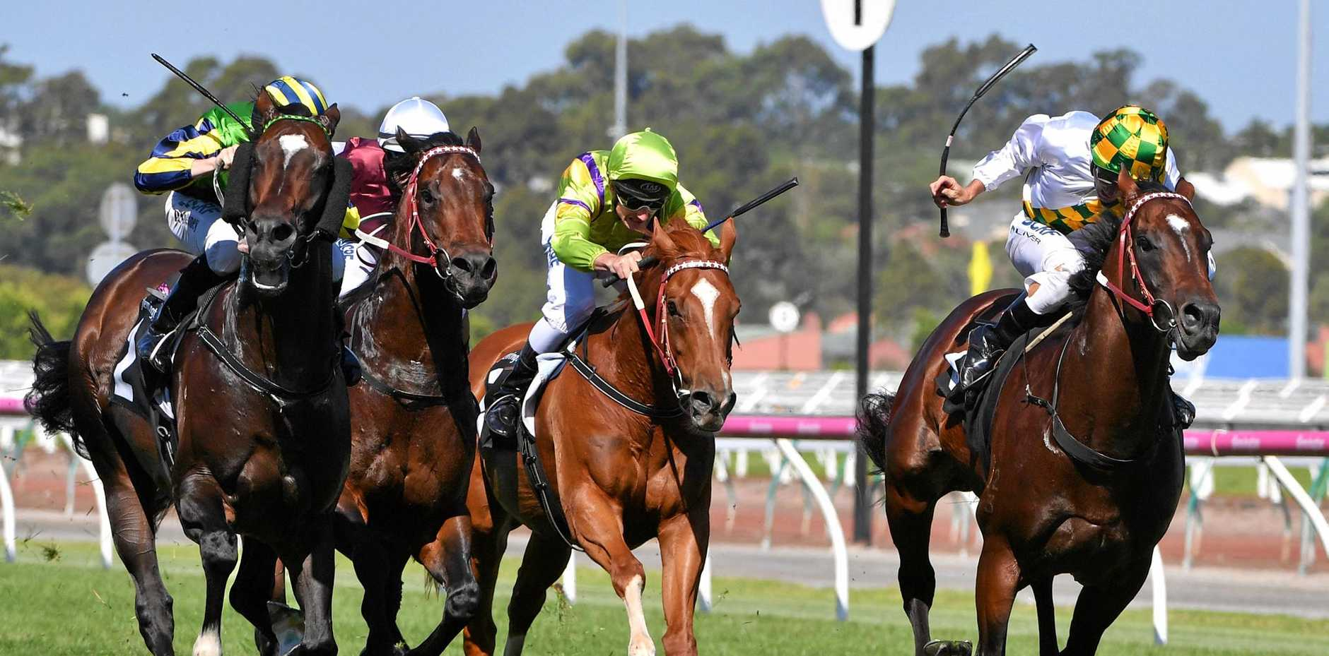 Patrick Moloney guides Tivaci (left) to a win over the Damien Oliver-ridden El Divino (right) in the Kensington Stakes.