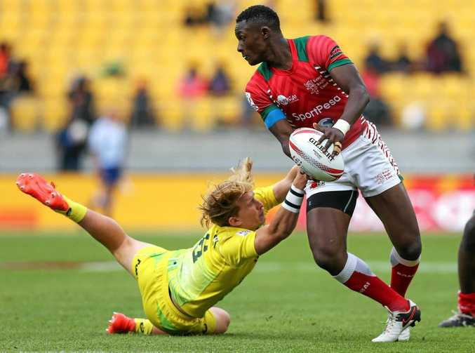 Eden Agero of Kenya is tackled by Tate McDermott of Australia in the playoff for ninth place at the Wellington Sevens yesterday.