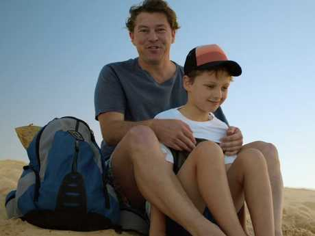 Riding the sand dunes of Moreton Island off Brisbane is among the activities used to demonstrate air safety in latest Qantas video.