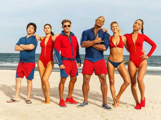 From left, Jon Bass, Alex Daddario, Zac Efron, Dwayne Johnson, Kelly Rohrbach, and Ilfenesh Hadera in a scene from the movie Baywatch.