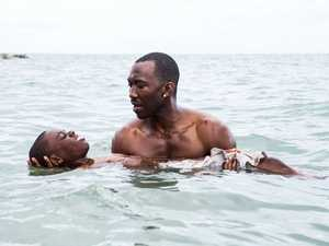 Mahershala Ali and Alex R Hibbert in a scene from the movie Moonlight.