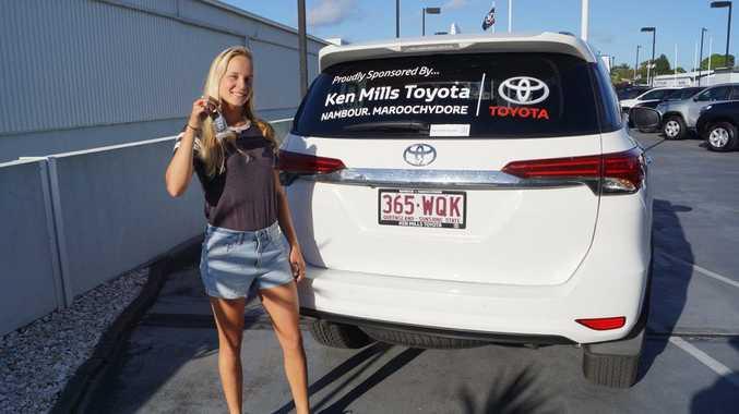 Junior World surfing champion Isabella Nichols with her Toyota Fortuner from Ken Mills Toyota Sunshine Coast.