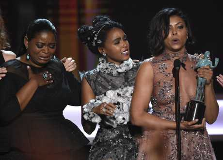 Octavia Spencer, from left, Janelle Monae, and Taraji P. Henson accept the award for outstanding performance by a cast in a motion picture for \