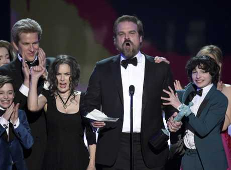 David Harbour and the cast of \