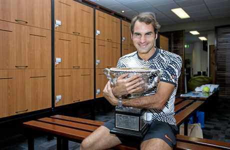 In a promotional handout image shows Roger Federer of Switzerland celebrating his win in the locker room in a posed photograph after winning the Mens Singles Final against Rafael Nadal of Spain on day fourteen of the Australian Open, in Melbourne, Australia, Sunday Jan. 29, 2017. (AAP Image/Tennis Australia/Fiona Hamilton) NO ARCHIVING, EDITORIAL USE ONLY