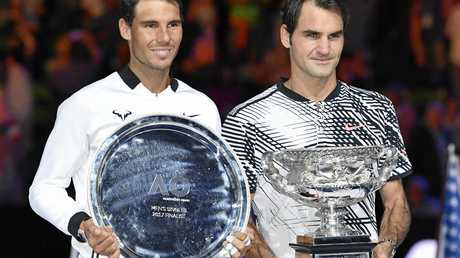 Roger Federer of Switzerland (R) holds the trophy after winning the men's single final against Rafael Nadal of Spain (L) at the Australian Open tennis tournament in Melbourne, Australia on Jan.29, 2017. 35-year-old Federer won by 6-4, 3-6, 6-1, 3-6, 6-3, claimed the 5th the Australian Open title since 2010 and extended his 18th Grand Slam career titles. ( The Yomiuri Shimbun via AP Images )