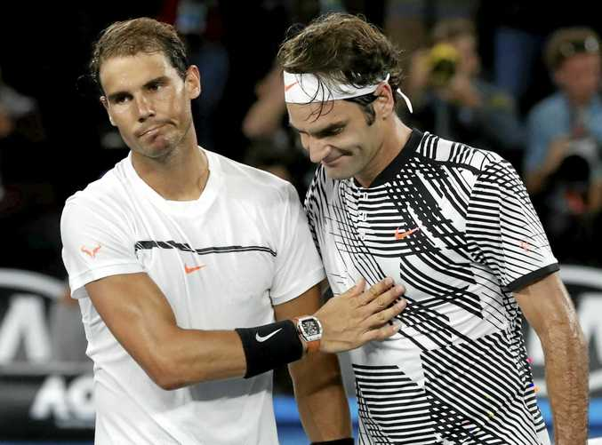 Switzerland's Roger Federer, right, is congratulated by Spain's Rafael Nadal, after the men's singles final at the Australian Open