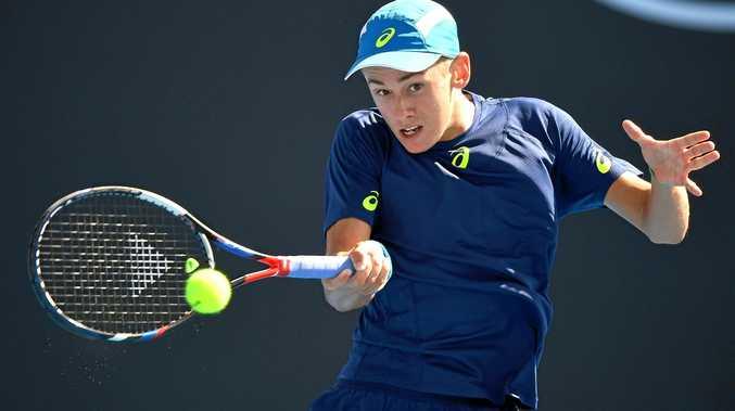 Alex De Minaur  in action against Sam Querrey of the United States at the Australian Open in Melbourne