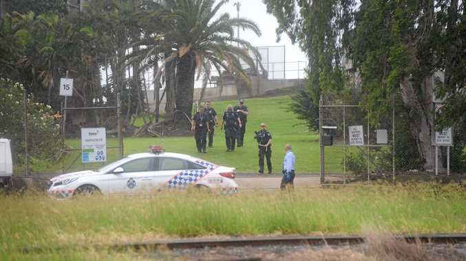 CHASE: Police officers at the East Bundaberg Water Treatment Plant, where members of the public reported Cobey Ian Duncan, 30, walking around with a piece of metal.