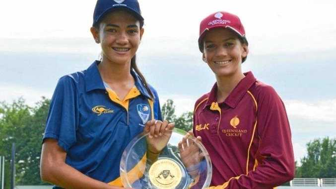 CAPTAINS: ACT/NSW Country captain holding the winning shield with Queensland captain and former Mackay junior Charli Knott at the U15 Female National Championships in Canberra last week.