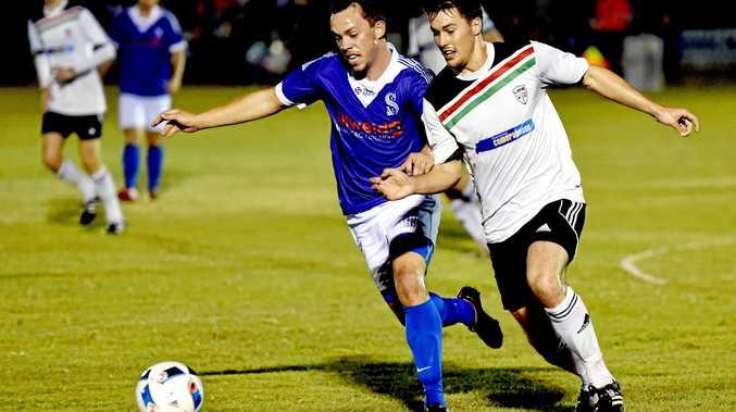 Maryborough football / soccer Sunbury versus United Park Eagles -  Sunbury's Lyndon Linwood and UPE's Brendan Davis. Photo: Valerie Horton / Fraser Coast Chronicle