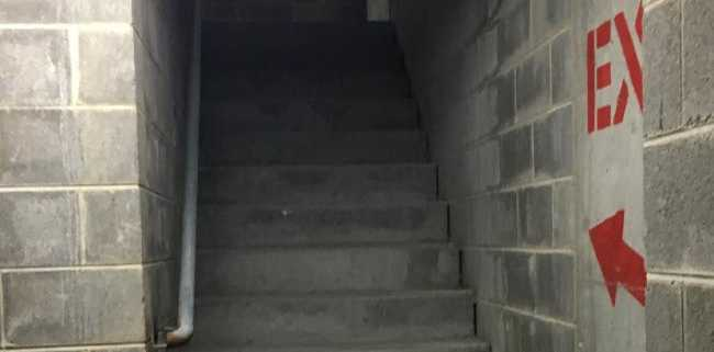 The body of 71-year-old Bernard Gore lay undiscovered in the Westfield Bondi Junction stairwell (above) for three weeks after he disappeared from the level four shops.