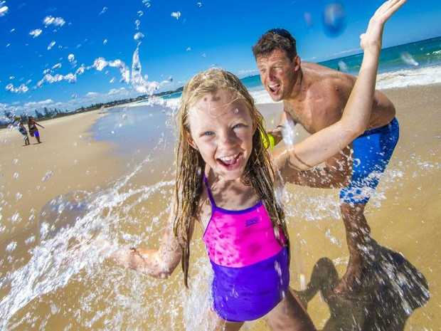 Paul Dooley splashes out with daughter Kobi, 9, at North Kirra Beach.