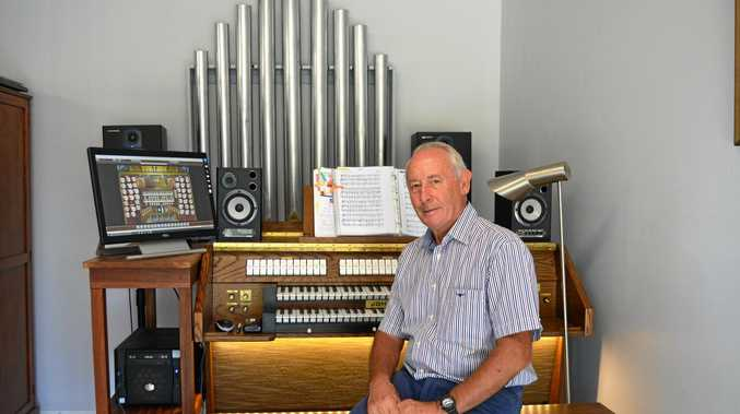 Gary Young sits proudly on his newly built virtual pipe organ at his home in Thornton.