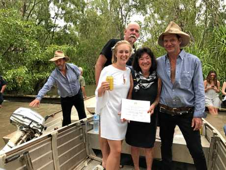 NT couple Des Barritt and Telka Zotz-Wilson were married by celebrant Nola Sweetman afloat a flooded river.