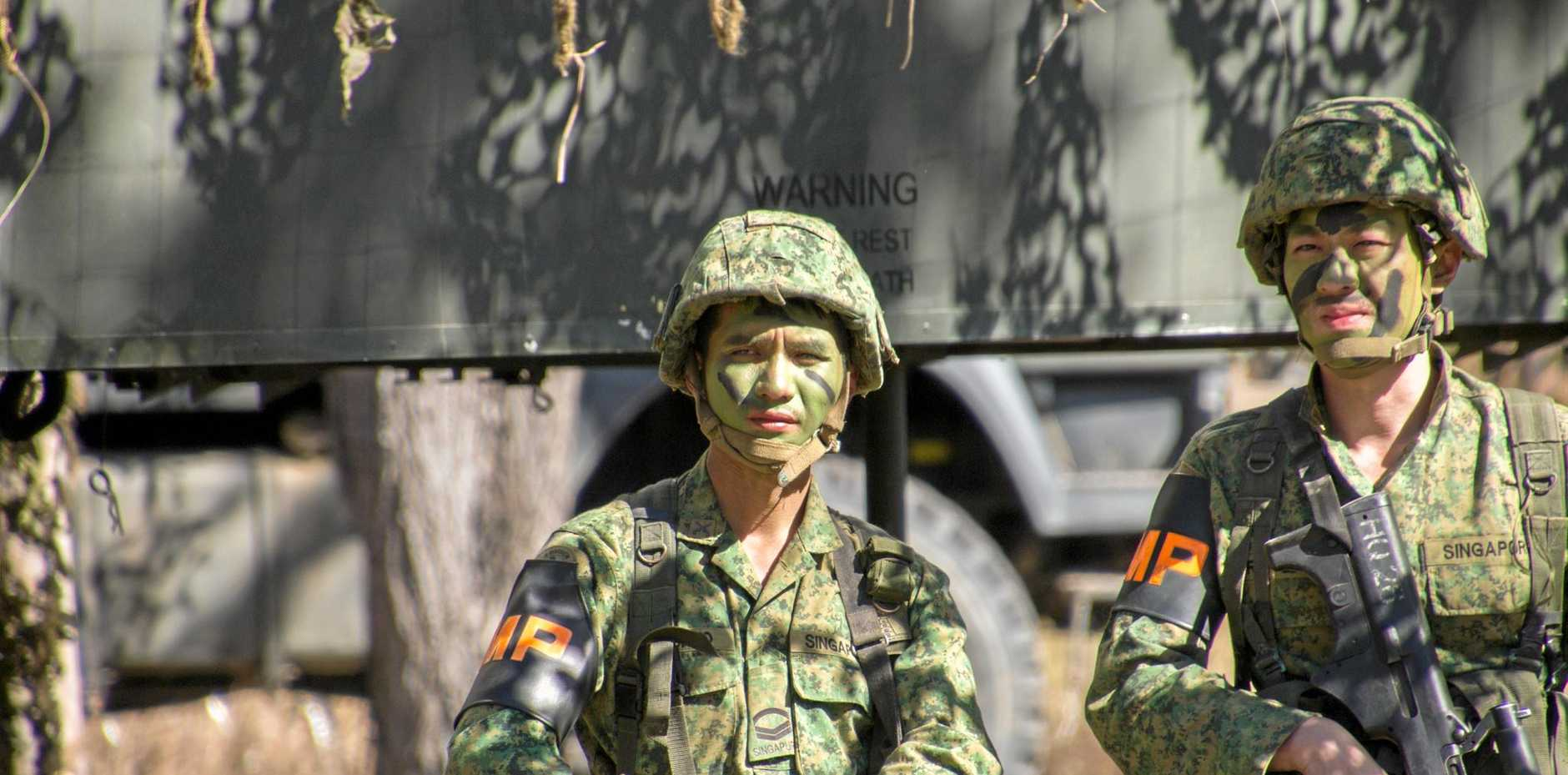 Singapore Army soldiers at the Shoalwater Bay Military Training Area. INSET: Annastacia Palaszczuk and Tim Nicholls have slammed the Federal Government for their approach to land acquisitions under the proposed expansion.