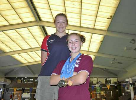 Pool life saving champion Imogen Saunders (right) and her coach Hayley Wolff.