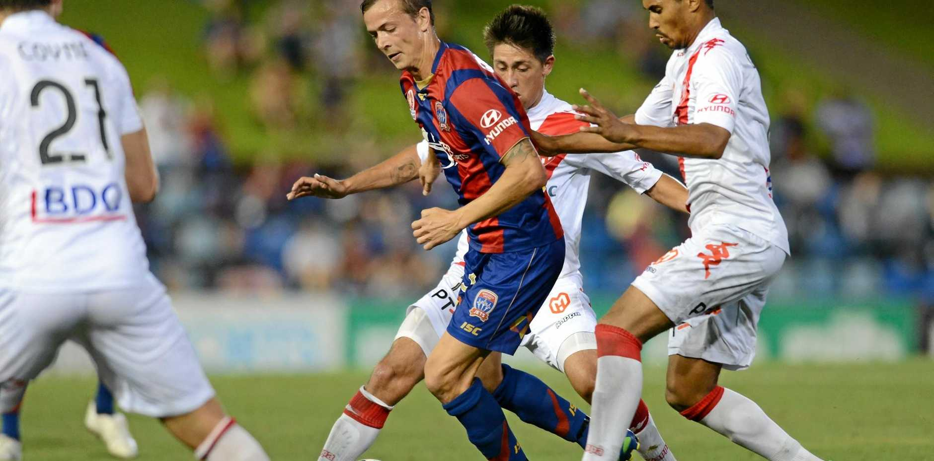 Ryan Griffiths playing for the Newcastle Jets in 2013.