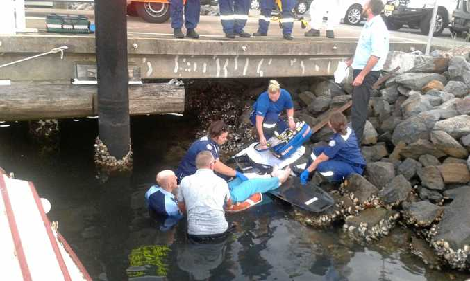 HELPING HAND: An off-duty Marine Rescue Pt Danger volunteer saves a woman who was badly injured.