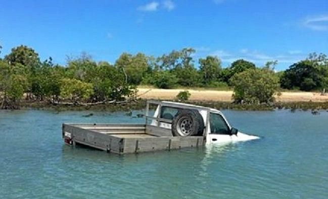 The ute bogged and submerged in sea water at Cape Palmerston.