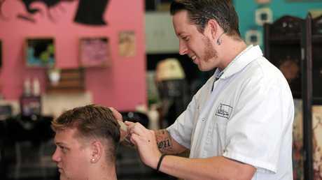 Zech Elliot cutting Jason Wasson's hair at the Hair and Beauty Temple. Zech has been voted Bundys favourite barber.