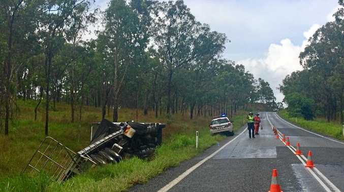 A truck has rolled over on the Peak Downs highway.