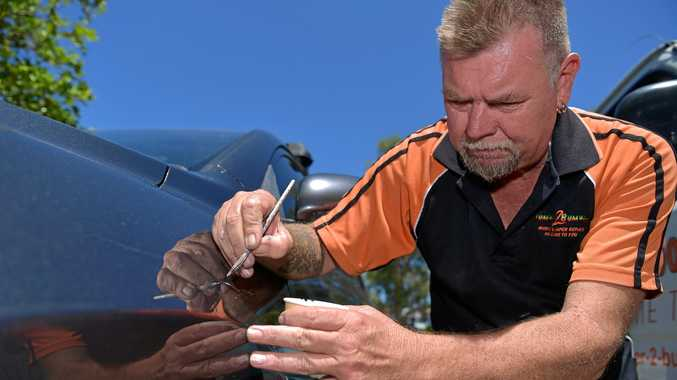 MARK MAN: Repairing keyed cars is keeping Bumper 2 Bumper owner Steve Jackson busy.
