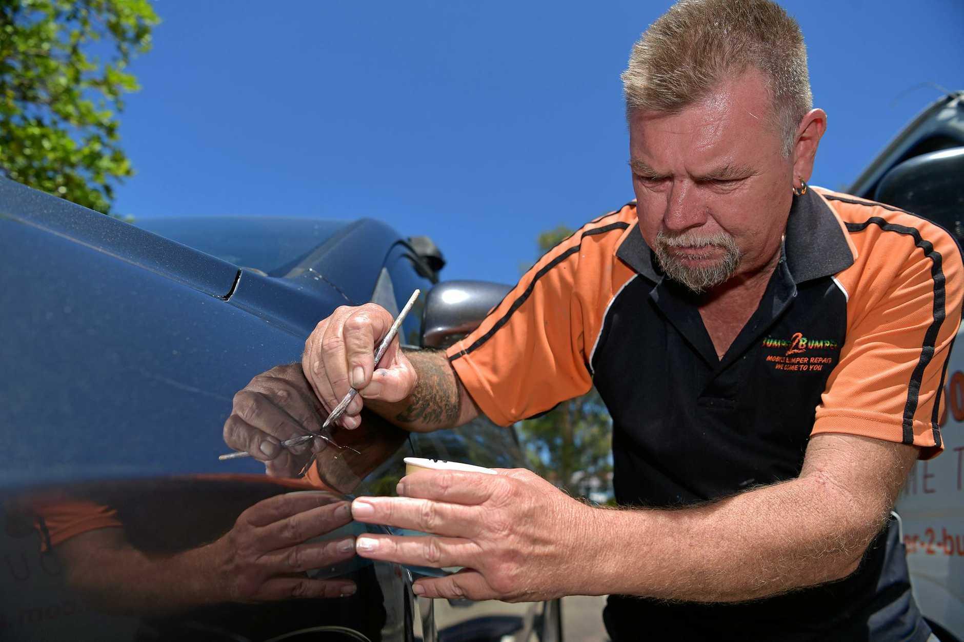 MARK MAN: Repairing keyed cars is keeping Bumper 2 Bumper owner Steve Jackson busy.